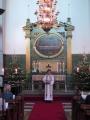 Draudzes mācītāja Elīza Zikmane ievada Ziemsvētku dievkalpojumu