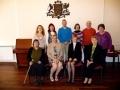 2009. gada 14. martā DVF namā Londonā notika draudzes padomes sēde. Jaunievēlētā draudzes valde. Augšējā rindā no kreisās: Terēze Bogdanova, Anita Rulle, Normunds Barons, Rita Rumba, Aivars Upmacis, Valda Rumba-Bryden. Apakšējā rindā no kreisās: Dace Pavasars, draudzes priekšniece Rūta Abakuka, māc. Elīza Zikmane, Ārija Brūniņa.