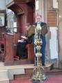 Lasījumu no Vecās derības lasa draudzes priekšnieks Andris Tauriņš