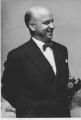 Trimdas latvietis prāvests Ringolds Mužiks kalpoja kā mācītājs Rietumanglijas un Dienvidanglijas, bet no 1962. gada Londonas Miera draudzē.